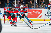 KELOWNA, CANADA - NOVEMBER 14: Cal Foote #25 moves the puck away from James Porter #1 of the Kelowna Rockets during third period against the Edmonton Oil Kings on November 14, 2017 at Prospera Place in Kelowna, British Columbia, Canada.  (Photo by Marissa Baecker/Shoot the Breeze)  *** Local Caption ***