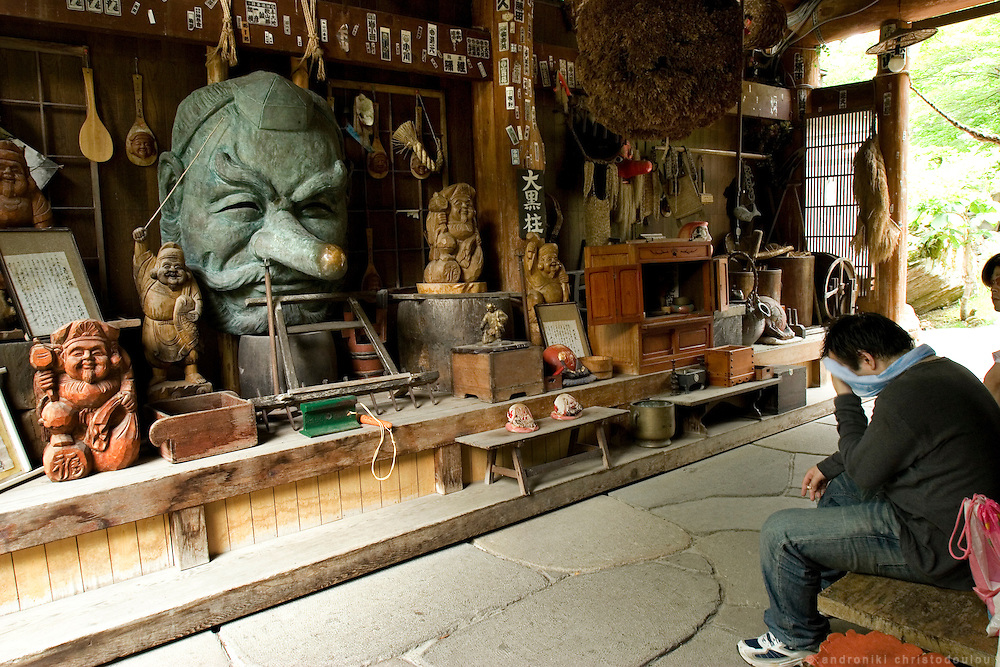 Visitor relaxing after having a bath, at the kiosk with the forest spirits' statues, of the Takaragawa onsen (hot spring) in Gunma prefecture north of Tokyo. - JAPAN 8 July 2006