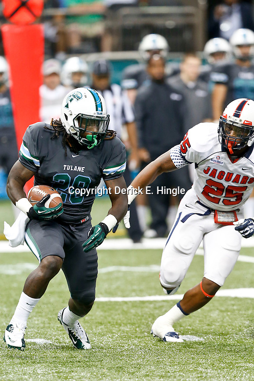 Sep 7, 2013; New Orleans, LA, USA; Tulane Green Wave running back Rob Kelley (28) is pursued by South Alabama Jaguars outside linebacker Clifton Crews (25) during the first quarter of a game at the Mercedes-Benz Superdome. Mandatory Credit: Derick E. Hingle-USA TODAY Sports