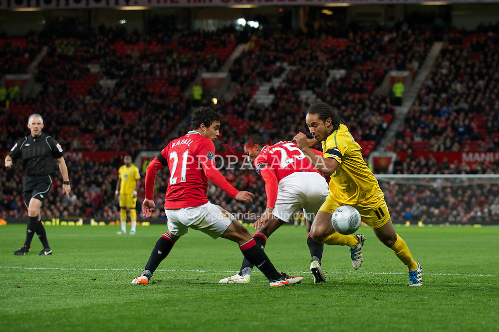 MANCHESTER, ENGLAND - Wednesday, November 29, 2011: Manchester United's Rafael da Silva and Antonio Valencia are turned by Crystal Palace's Sean Scannell during the Football League Cup Quarter-Final match at Old Trafford. (Pic by David Rawcliffe/Propaganda)
