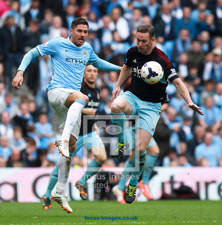 Javi Garcia of Manchester City and Kevin Nolan of West Ham United during the Barclays Premier League match at the Etihad Stadium, Manchester<br /> Picture by John Rainford/Focus Images Ltd +44 7506 538356<br /> 11/05/2014