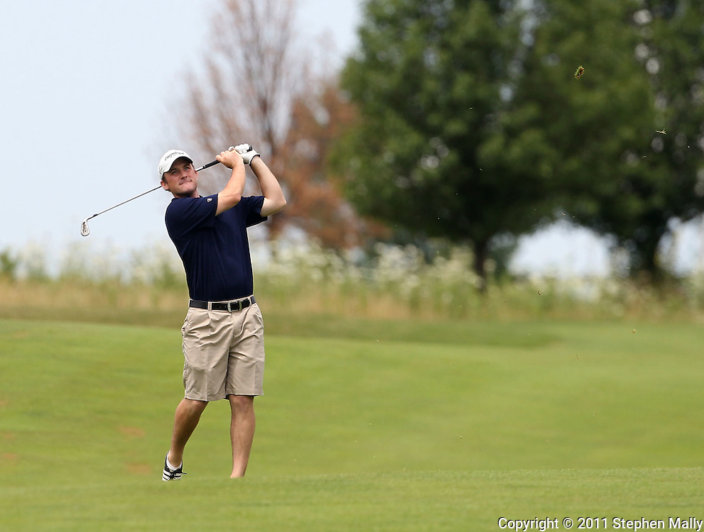 Brian Brodell of Verona, Wisconsin watches his shot on the tenth hole during the second round of the Greater Cedar Rapids Open held at Hunters Ridge Golf Course in Marion on Saturday, July 23, 2011.