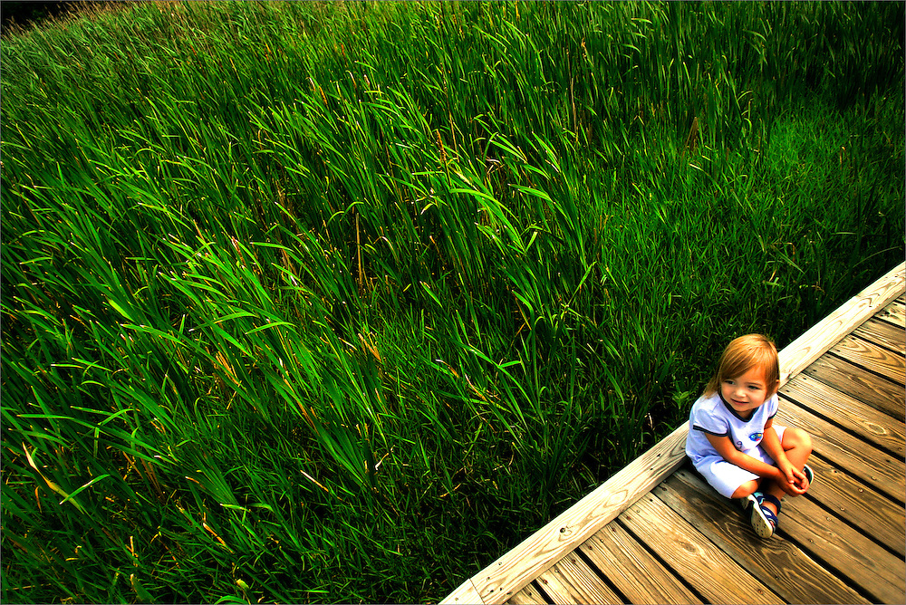 "A young child enjoys a slice of what ""Mother Nature"" has to offer on a boardwalk portion of the Appalachian Trail in Vernon, New Jersey on June 27, 2006."