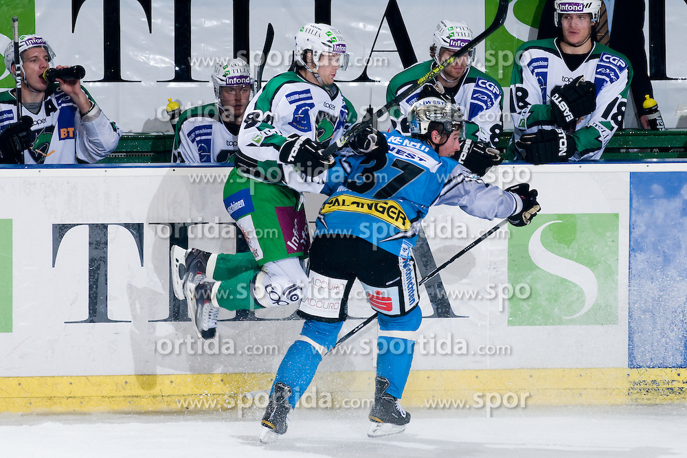 Andrej Hebar (HDD Tilia Olimpija, #84) vs Aaron Mckenzie (EHC Liwest Black Wings Linz, #37) during ice-hockey match between HDD Tilia Olimpija and EHC Liwest Black Wings Linz in 19th Round of EBEL league, on November 7, 2010 at Hala Tivoli, Ljubljana, Slovenia. (Photo By Matic Klansek Velej / Sportida.com)