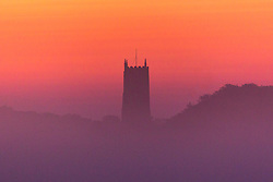 © Licensed to London News Pictures. 03/09/2018. Blakeney UK. The sky turns a vivid orange & red at dawn this morning behind St Nicholas church in Blakeney on the Norfolk coast.  Photo credit: Andrew McCaren/LNP