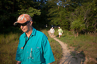ANGLER WALKING A TRAIL LEADING TO THE MOUNTAIN FORK RIVER NEAR BROKEN BOW OKLAHOMA