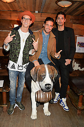 Left to right, OLIVER PROUDLOCK, SPENCER MATTHEWS and HUGO TAYLOR at Skiing With Heroes Junior Committee Awareness Party held at Bodo's Schloss, 2A Kensington High Street, London on 6th November 2014.