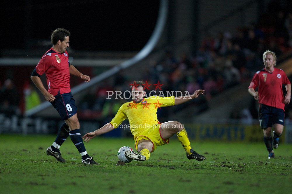 WREXHAM, WALES - Wednesday, February 6, 2008: Wales' Carl Fletcher and Norway's Martin Andersen during an international friendly match at the Racecourse Ground. (Photo by David Rawcliffe/Propaganda)