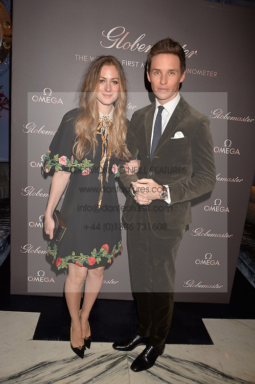 LONDON, ENGLAND 8 DECEMBER 2016: Eddie Redmayne, Hannah Redmayne at the Omega Constellation Globemaster Dinner at Marcus, The Berkeley Hotel, Wilton Place, London England. 8 December 2016.