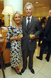 MR & MRS ROD FABRICIUS at a party hosted by Links of London to celebrate the forthcoming Glorious Goodwood racing event held at links, Sloane Square, London on 25th July 2007.<br />