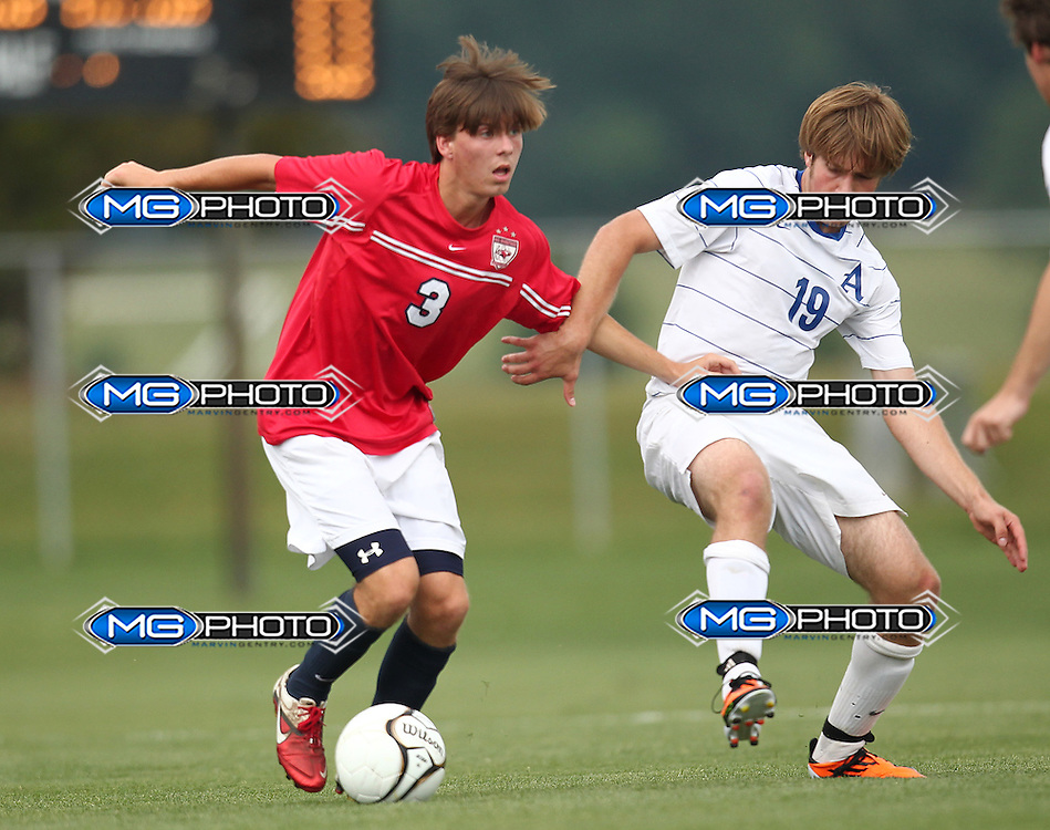 May 12, 2012; Huntsville, AL, USA;  Oak Mountain's Wes Sandlin (3) pushes away Auburn's Alec Rhodes (19).Mandatory Credit: Marvin Gentry