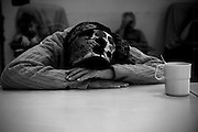 A Holocaust survivo rlays her head on the table in the Shaar Menashe Mental Health Center for Holocaust survivors in Pardes Hanna, Israel on Oct 14, 2010.