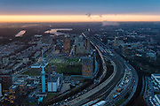 Nederland, Noord-Holland, Amsterdam, 16-01-2014; zicht op de Zuidas en de Ring A10 in de avondschemering en bij ondergaande zon. Omgeving Station Zuid-WTC, World Trade Centre (WTC) en hoofdkantoor ABN-AMRO, Ernst &amp; Jong.<br /> Verder in beeld de woontorens Symphony 1 en 2 (onderdeel Gershwin), de Vinoly-toren en Ito-toren (onderdeel Mahler4), Atrium.<br /> Zuid-as, 'South axis', financial center in the South of Amsterdam, with o.a. headquarters of former ABN AMRO, World Trade Centre (WTC) en Ring Road A10. Amsterdam equivalent of 'the City', financial district. <br /> luchtfoto (toeslag op standaard tarieven);<br /> aerial photo (additional fee required);<br /> copyright foto/photo Siebe Swart.<br /> aerial photo (additional fee required);<br /> copyright foto/photo Siebe Swart.