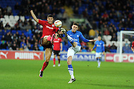 Cardiff city's Rudy Gestede (l) battles for the ball with Peterborough's Shaun Brisley. NPower championship, Cardiff city v Peterborough Utd at the Cardiff city stadium in Cardiff, South Wales on Sat 15th Dec 2012. pic by Andrew Orchard, Andrew Orchard sports photography,
