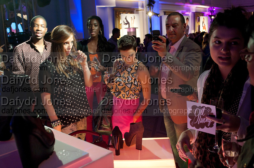 ALEX GROWCOK; JADE DAVID, ( OH MY ) LOOKING AT SHOES Aldo launch. One Marylebone Rd. London. 21 June 2011<br /> <br />  , -DO NOT ARCHIVE-© Copyright Photograph by Dafydd Jones. 248 Clapham Rd. London SW9 0PZ. Tel 0207 820 0771. www.dafjones.com.