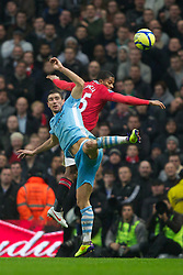 MANCHESTER, ENGLAND - Sunday, January 8, 2012: Manchester City's Aleksandar Kolarov in action against Manchester United's Antonio Valencia during the FA Cup 3rd Round match at the City of Manchester Stadium. (Pic by Vegard Grott/Propaganda)