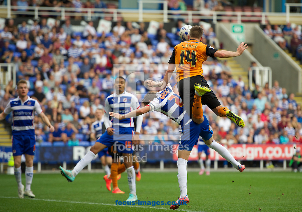 Lee Evans of Wolverhampton Wanderers gets up high above Chris Gunter of Reading to win the header during the Sky Bet Championship match at the Madejski Stadium, Reading<br /> Picture by Alan Stanford/Focus Images Ltd +44 7915 056117<br /> 28/09/2014