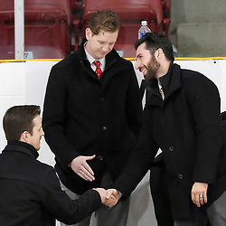 TRENTON, ON  - MAY 5,  2017: Canadian Junior Hockey League, Central Canadian Jr. &quot;A&quot; Championship. The Dudley Hewitt Cup. Game 7 between The Georgetown Raiders and The Powassan Voodoos. Georgetown Raiders Assistant Coaches celebrate after the win. <br /> (Photo by Amy Deroche / OJHL Images)