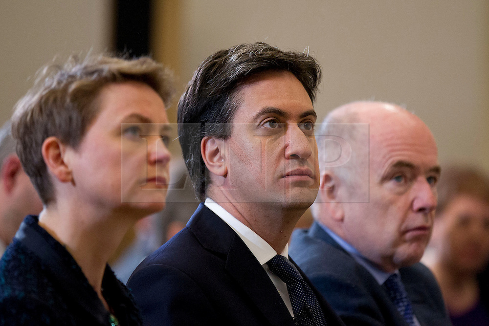 © Licensed to London News Pictures. 25/11/2013. London, UK. The shadow home secretary Yvette Cooper (L), Labour leader Ed Miliband (C) and the shadow policing minister Jack Dromey listen during the presentation of a report by the Independent Commission on the future of Policing in England and Wales, at the Royal Society of Arts in London today (25/11/2013). Photo credit: Matt Cetti-Roberts/LNP