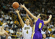 December 22 2010: Iowa guard Megan Considine (4) puts up a shot over Northern Iowa forward Amber Kirschbaum (0) during the second half of an NCAA college basketball game at Carver-Hawkeye Arena in Iowa City, Iowa on December 22, 2010. Iowa defeated Northern Iowa 75-64.