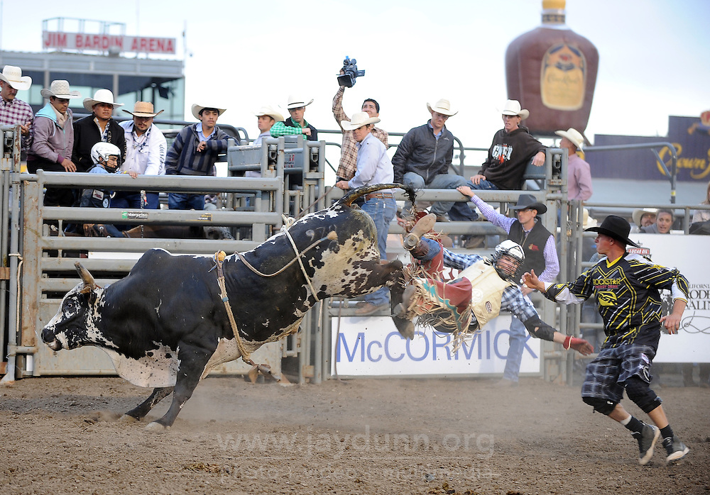 Cody Sierks takes flight off of Big Jake in the second round of Wednesday's 2013 PBR Touring Pro Division event at the Salinas Sports Complex.