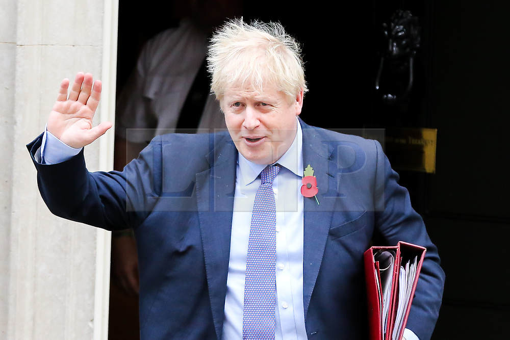 © Licensed to London News Pictures. 30/10/2019. London, UK. British Prime Minister BORIS JOHNSON departs from Number 10 Downing Street to attend Prime Minister's Questions (PMQs) in the House of Commons. On Tuesday 29 October 2019 MPs voted for a UK general election on 12 December 2019. Photo credit: Dinendra Haria/LNP