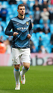 Edin Dzeko of Manchester City warms up before the Barclays Premier League match at the Etihad Stadium, Manchester<br /> Picture by John Rainford/Focus Images Ltd +44 7506 538356<br /> 11/05/2014