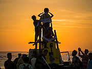 "09 NOVEMBER 2014 - SITTWE, RAKHINE, MYANMAR: Burmese teenagers have a street party at the ""viewpoint,"" the southern most point in Sittwe. The viewpoint overlooks the Bay of Bengal. Sittwe is a small town in the Myanmar state of Rakhine, on the Bay of Bengal.  PHOTO BY JACK KURTZ"