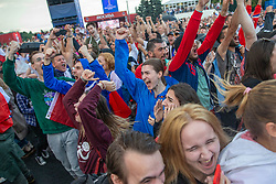 Russia fans celebrating in the fan zone in Moscow their victory over Spain in their last 16 match in the 2018 Russia World Cup.