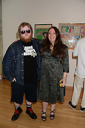 BILL DURY son of Ian Dury and his mother SOPHIE DURY Ian Dury's 2nd wife at a private view of the late Ian Dury's artwork entitled Ian Dury: More Than Fair – Paintings, drawings and artworks, 1961–1972 held at the Royal College of Art, Kensington Gore, London SW7 on 22nd July 2013.