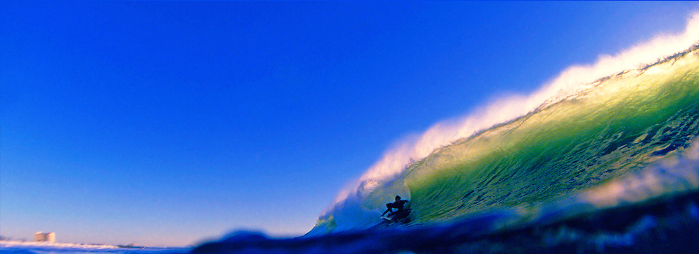 A Surfer Riding Inside a Wave