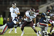 Texas A&M running back Ben Malena (1) is tackled by Ole Miss linebacker Denzel Nkemdiche (4) in Oxford, Miss. on Saturday, October 6, 2012. Texas A&M won 30-27...