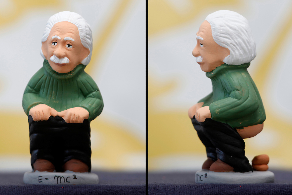 "November 10,  2010. A company in Torroella de Montgrí (Girona, Spain) called ""Caganer.com"", which specializes in the production of ""caganers"", unveiled today its new figurine for Christmas, Michael Jackson, Josn Lennon or prince Charles. .A ""Caganer"" is a small figure from Catalonia, usually made of fired clay, which depicts as squatting person in the act defecating..""Caganer"" is Catalan for pooper. It forms part of one of the typical figures of the manger or ""Nativity"" scene together with Mary, Joseph and the baby Jesus but hidden in a corner. It is a humorous figure, originally portraying a peasant wearing a ""barretina"" (a red stocking hat), and seems to date from the 18th century when it was believed that the figure's deposits would fertilize the earth to bring a prosperous year. With the course of time, the original personage of this pooping figure was substituted with personalities from the political and sports worlds and other famous personalities..German physicist Albert Einstein."