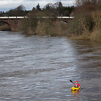 Officers from a Police Scotland underwater search team in kayaks pictured on the River Tay Street in Perth where they today continued the search for a body after an off duty firefighter reported spotting a body in the river last night (Sunday 23.02.14). The search was halted at 9.30pm Sunday evening....24.02.14<br /> Picture by Graeme Hart.<br /> Copyright Perthshire Picture Agency<br /> Tel: 01738 623350  Mobile: 07990 594431