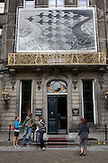 Tourists outside the MC Escher Museum, Lange Voorhout Palace in Dn Haag