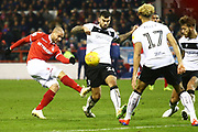 Nottingham Forest's Yohan Benalouane shoots at goal  during the EFL Sky Bet Championship match between Nottingham Forest and Bristol City at the City Ground, Nottingham, England on 19 January 2019.