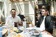 Oscar De La Hoya has lunch with his son, Devon, at the hotel in Grapevine, Texas before heading to the weigh-ins on September 16, 2016.  (Cooper Neill for ESPN)