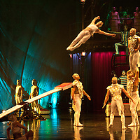 London, UK - 4 January 2012: Acrobats perform on the teeterboard during the Cirque Du Soleil Kooza dress rehearsal at the Royal Albert Hall. Since its premiere in April of ..2007, KOOZA has captivated close to four million spectators in North America and Japan.  London will be the first destination of the KOOZA European tour starting the ..5th of January. Written and directed by David Shiner, KOOZA is a return to the origins of Cirque du Soleil combining two circus traditions - acrobatic performance and ..the art of clowning.  KOOZA highlights the physical demands of human performance in all its splendor and fragility, presented in a colorful m&eacute;lange that emphasizes ..bold slapstick humor. This image can be quickly and easily purchased from some of the major international stock agencies:<br /> <br /> Alamy Images, following this link:<br /> http://tinyurl.com/avb24d4<br /> <br /> Demotix, following this link: <br /> http://tinyurl.com/a3mscez<br /> <br /> Barcroft, following this link:<br /> http://tinyurl.com/a6tkquz