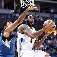 15 February 2017: Denver Nuggets guard Will Barton (5) goes for the reverse layup past Minnesota Timberwolves center Karl-Anthony Towns (32) during the Minnesota Timberwolves 112-99 victory over the Denver Nuggets, at the Pepsi Center, Denver, Colorado, USA.