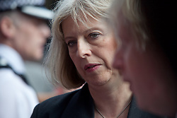 © London News Pictures. 09/08/11. Home Secretary Theresa May. Mayor of London, Boris Johnson visits Clapham Junction during the mass public clean up of the streets. This event has been organised through the social media of Twitter which was attended by up to 350 twitters.