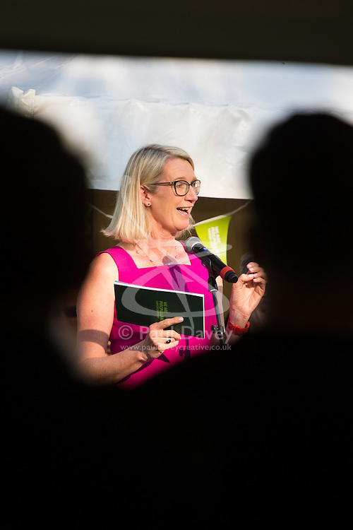 Westminster, London, June 6th 2016. Linda Thomas of McMillan addresses the crowd as teams from uk industry as well as the House of Commons and the House of Lords compete in the annual McMillan Cancer Charity tug o' war.