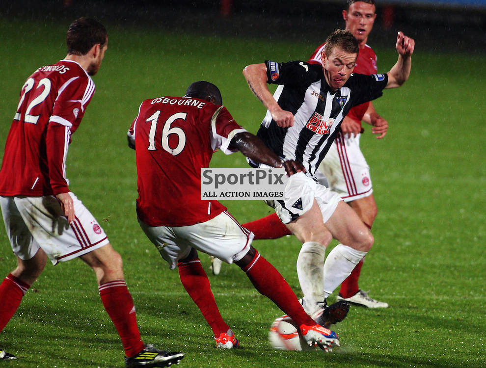 Dunfermline Athletic v Aberdeen Scottish Communities League Cup 3rd Round East End Park 26 September 2012..Andy Geggan challegnes Isaac Osborne..(c) Craig Brown | StockPix.eu