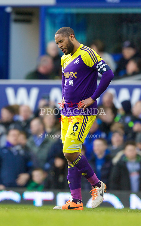 LIVERPOOL, ENGLAND - Sunday, February 16, 2014: Ashley Williams of Swansea City shows a look of dejection after conceding a penalty during the FA Cup 5th Round match against Everton at Goodison Park. (Pic by David Rawcliffe/Propaganda)