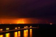 Lightnings by the bridge at night time
