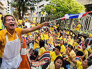 "05 DECEMBER 2014 - BANGKOK, THAILAND: A Thai woman exhorts the crowd to chant ""Long Live the King!"" in front of Siriraj Hospital on the 87th birthday of Bhumibol Adulyadej, the King of Thailand. The revered Monarch was scheduled to make a rare public appearance in the Grand Palace but cancelled at the last minute on the instructions of his doctors. He has been hospitalized in Siriraj Hospital, across the Chao Phraya River from the Palace, since early October.    PHOTO BY JACK KURTZ"