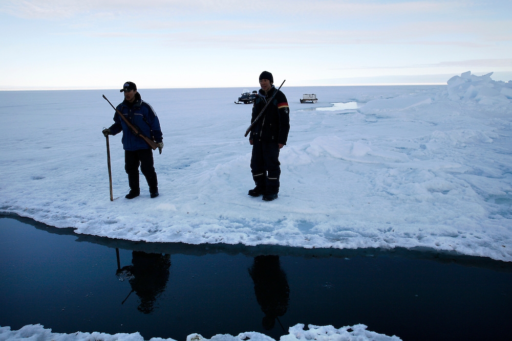 Tomi Salovinik 19  and Manik 16  checking the ice next to a crack in the ice  to know from where they can cross it on the way to Seals hunt in Resolute Bay. Tuesday June 12 2007 ..Inuit?s hunting seals for food, every part of the seals is used or for food or for worm cloth...