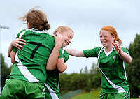 14 Aug 2016:   Kayleigh McLoughlin, centre, Mayo, celebrates with team-mates Maggie Chambers, left, and Miamh O'Malley, right, after scoring the winning goal in the penalty shoot-out of Girls U13 futsal 2nd/3rd place play-off, Mayo v Tipperary.  2016 Community Games National Festival 2016.  Athlone Institute of Technology, Athlone, Co. Westmeath. Picture: Caroline Quinn