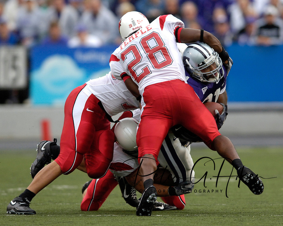 Kansas State's running game was bottled up all night, as Wildcat running back Carlos Alsup was wrapped up by the Illinois State defense, at Bill Snyder Family Stadium in Manhattan, Kansas, September 2, 2006.  The Wildcats beat the Redbirds 24-23.