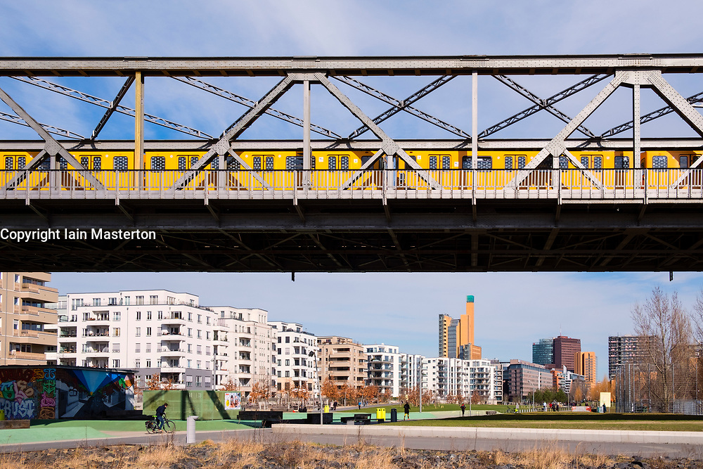 View of Gleisdreieck Park with modern new luxury housing and railway bridge adjacent in Berlin, Germany