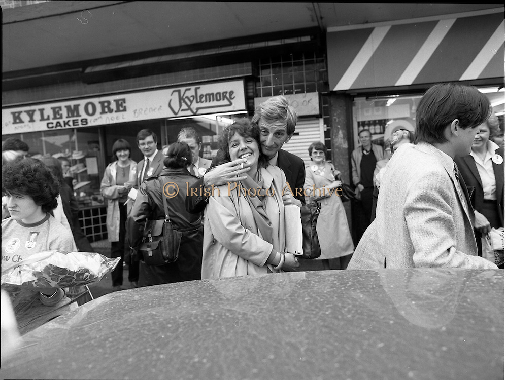 15/05/1982<br /> 05/15/1982<br /> 15 May 1982<br /> An Taoiseach, Mr Charles Haughey, canvasing with Fianna Fail bye-election candidate Eileen Lemass in Dublin West. Image taken outside Kylemore Cakes, Ballyfermot Road.